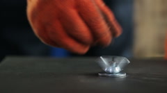 An employee at the plant twists the wing nut on metallic surface Stock Footage