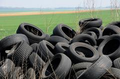 a pile of waste tires in Arthies - stock photo