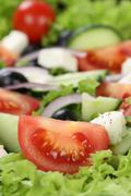 Greek salad with tomatoes, Feta cheese, olives and copyspace Stock Photos