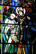 stained glass window of Beuvron en Auge church in Normandy - stock photo