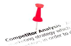Closeup shot over words Competitor Analysis on paper - stock photo