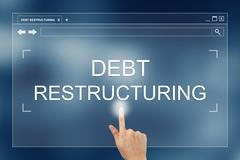 hand press on debt restructuring button on website - stock photo