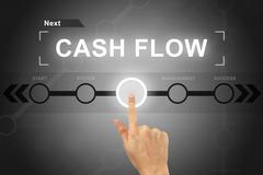 hand clicking cash flow button on a screen interface - stock photo