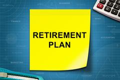 Retirement plan word on yellow note Stock Photos