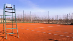 Empty chair Red clay tennis court Stock Footage