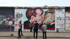 The Berlin wall (Berliner Mauer) with graffiti - stock footage