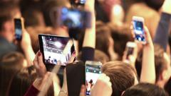 Many viewers are shooting a fashion show on a mobile device. - stock footage