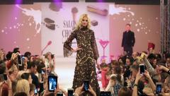 Girl model show the audience dresses during the fashion show. Salon du Chocolat. Stock Footage