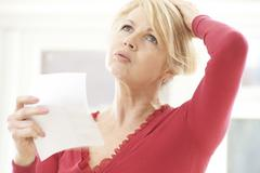 Mature Woman Experiencing Hot Flush From Menopause - stock photo