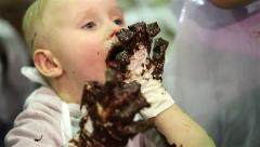 Little boy smeared with chocolate. - stock footage