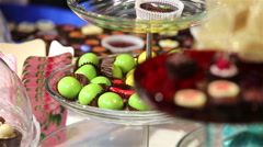 Lots of chocolates on display. The seller lays out candy on display. - stock footage