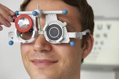 Man Having Sight Test At Optometrist - stock photo
