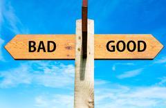 GOOD versus BAD messages written on opposite arrows - stock photo