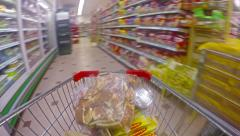 4K shopping wagon cart moving through store realtime. UHD stock video - stock footage