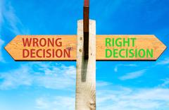 WRONG DECISION versus RIGHT DECISION messages written on opposite arrows.  - stock photo