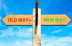 OLD WAY versus NEW WAY messages written on opposite arrows.  - stock photo
