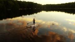 Stunning Aerial SUP Shot at Sunset Stock Footage