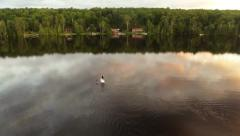 Aerial fly over shot of Stand Up Paddle boarder Stock Footage