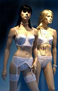 France, dummies in a display window in Paris - stock photo