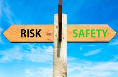 Risk versus Safety messages written on opposite arrows.  Stock Photos