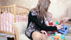 Mother and father playing toys with little daughter in domestic room Stock Footage