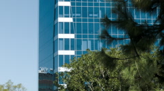ESTABLISHING SHOT OF GLASS OFFICE BUILDING EXTERIOR Stock Footage