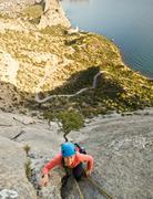 Rock climber ascend the mountain Stock Photos