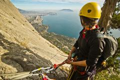 Rock climbers ascend the mountain Stock Photos