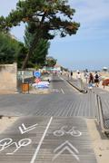 France, cyclist on a walkway in Arcachon Stock Photos