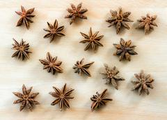 Star anise was placed on top of the wooden board Stock Photos
