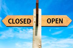 Closed versus Open messages written on opposite arrows.  - stock photo