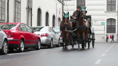 Carrier rolls tourists in  carriage harnessed by couple of horses Stock Footage
