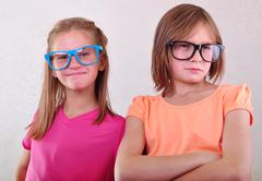 Playful girlfriends with eyeglasses Stock Photos
