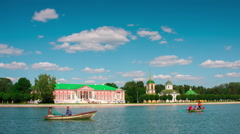 Kuskovo palace and pond with boats in sunny summer day,Moscow, timelapse Stock Footage