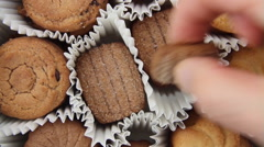 Taking out different varieties of cookies Stock Footage