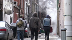 People Walking in an Alley Stock Footage