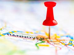 Stock Photo of Red pushpin showing Hannover City On Map, Germany, Travel Destination Concept