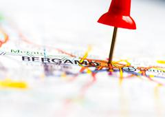 Stock Photo of Red pushpin showing Bergamo City On Map, Italy, Travel Destination Concept