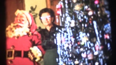 Mom or grandmother with Santa Clause - stock footage