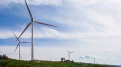 Stock Video Footage of Wind turbine generators on top of a hill