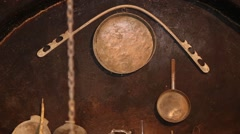 Traditional kitchen utensils hanging on the wall - stock footage