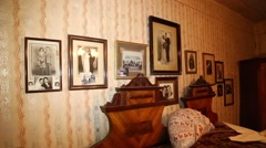 Vintage bedroom with old photos on the wall Stock Footage