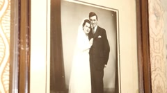 Old wedding photo on the wall Stock Footage