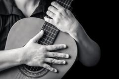 Musician hands playing a classic guitar Kuvituskuvat