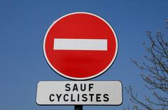 one way traffic except for cyclists - stock photo