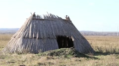 Neolithic straw house replica - stock footage