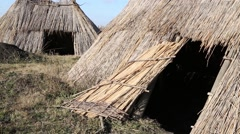 Replica of a neolithic straw huts - stock footage