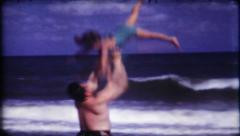 1819 - father & daughter having fun at the beach - vintage film home movie - stock footage