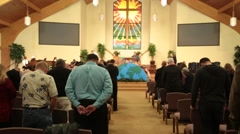 Crowd of people praying at church Stock Footage