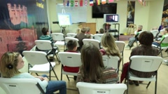 Group of Church People Seated While Watching an Instructional Video Stock Footage